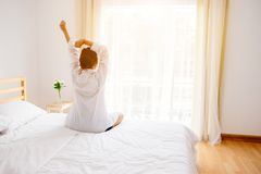 Woman waking up. Royalty Free Stock Photos