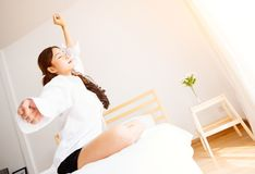 Asian women are waking up in the morning bright Royalty Free Stock Photos
