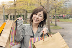 Asian woman walk and hold shopping bags Stock Photos