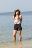 Asian woman walk on tropical beach Stock Photography
