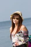 Asian woman walk on tropical beach Stock Image