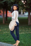 Asian woman walking in park Stock Photography