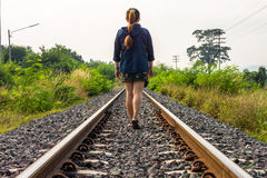 Asian woman walking on railway track Royalty Free Stock Photo