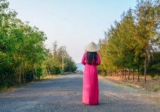 An Asian woman walking on road stock photo