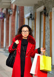 An Asian woman walking in the street royalty free stock photos