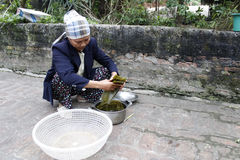 Asian woman wash leaf to packing rice cake Royalty Free Stock Image