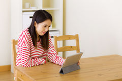 Asian woman watching movie on digital tablet Stock Images