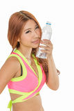 Asian woman with water bottle after exercise Royalty Free Stock Photos
