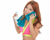 Asian woman with water bottle and towel Royalty Free Stock Image