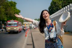 Woman waving her hands to get on the tuk-tuk royalty free stock image