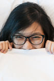 Asian woman wear eyeglasses waking up. Royalty Free Stock Photography