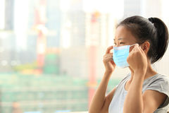 Asian woman wear face mask in city Royalty Free Stock Photo