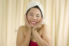 Asian woman wear a skirt to cover her breast after wash hair, Wrapped in Towels After Shower royalty free stock photos