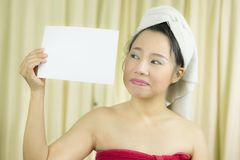 Asian woman wear a skirt to cover her breast after wash hair, Wrapped in Towels After Shower holding empty blank banner and acting royalty free stock photos