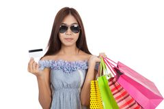 Asian woman wear sunglasses  hold shopping bags show a credit ca Stock Image