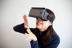 Asian Woman wear vr device and feeling afraid Stock Photo