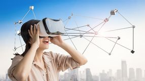 Enjoy vr headset. Asian woman wear vr headset and enjoy experience Stock Image