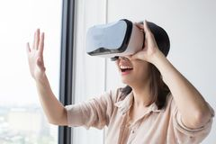 Enjoy vr headset. Asian woman wear vr headset and enjoy experience Stock Images