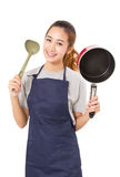Asian Woman Wearing Apron And Showing Pan With Utensil. Asian Woman Wearing Apron And Showing Pan With Utensil Isolated On White Stock Photo