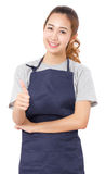 Asian Woman Wearing Apron And Showing Thumbs Up. Stock Photography