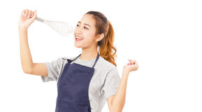 Asian Woman Wearing Apron And Singing With Whisk. Stock Photography