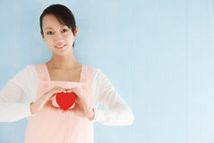 Asian woman wearing an apron to make a heart Stock Images