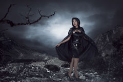 Asian woman wearing black costume Royalty Free Stock Photography