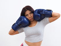 Asian woman wearing blue boxing gloves Royalty Free Stock Photo