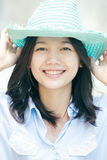 Asian woman wearing a blue hat with smiling face Royalty Free Stock Image