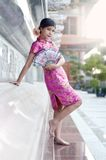 Asian woman wearing a cheongsam Royalty Free Stock Image