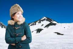Asian woman on snow mountain Stock Photo