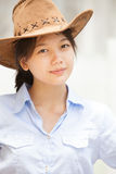 Asian woman wearing a hat Stock Images