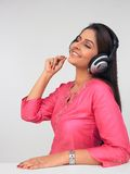 Asian woman wearing a headphone and listening to m Stock Images
