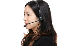 Asian woman wearing headset Royalty Free Stock Photography