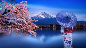 Asian woman wearing japanese traditional kimono at Fuji mountain and cherry blossom, Kawaguchiko lake in Japan royalty free stock images