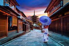 Asian woman wearing japanese traditional kimono at Yasaka Pagoda and Sannen Zaka Street in Kyoto, Japan royalty free stock image