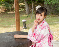 Asian woman wearing a kimono in Japanese garden Royalty Free Stock Images