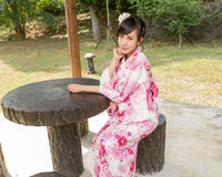 Asian woman wearing a kimono in Japanese garden Stock Image