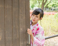 Asian woman wearing a kimono in Japanese garden Stock Photo