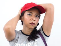 Asian woman wearing red cap Royalty Free Stock Images