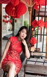 Asian woman wearing red traditional dress in chinese new year festival stock photography
