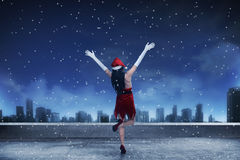Asian woman wearing santa claus costume, standing on the rooftop. Looking the city Royalty Free Stock Photos