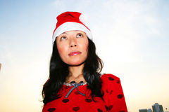 Asian woman wearing a Santa hat. Royalty Free Stock Photo