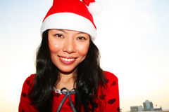 Asian woman wearing a Santa hat. Royalty Free Stock Photography