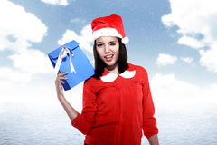 Asian woman wearing santa hat holding gift Royalty Free Stock Image