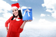 Asian woman wearing santa hat holding gift Stock Photo