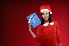 Asian woman wearing santa hat holding gift Royalty Free Stock Photo