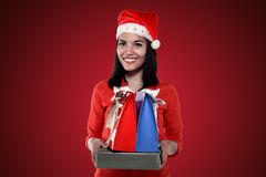 Asian woman wearing santa hat holding gift Royalty Free Stock Images