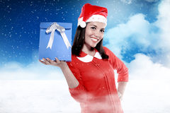 Asian woman wearing santa hat holding gift with smile expression Stock Images