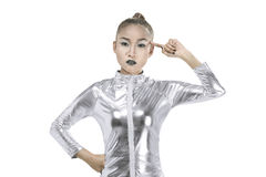 Asian woman wearing silver latex suit Stock Photo